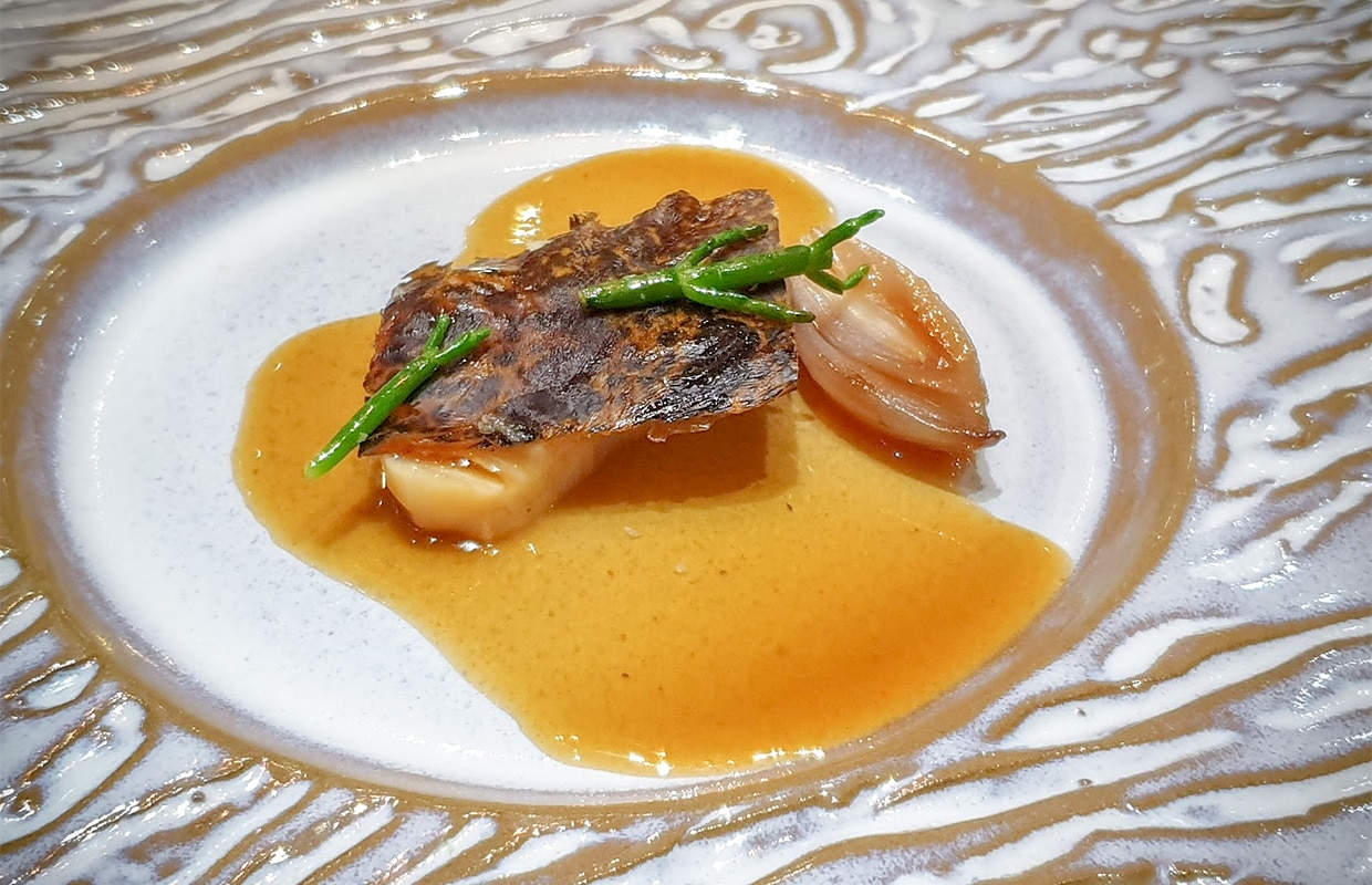 Crispy chicken-inspired 'escolar' fish with morey eel and Armagnac sauce - Aponiente